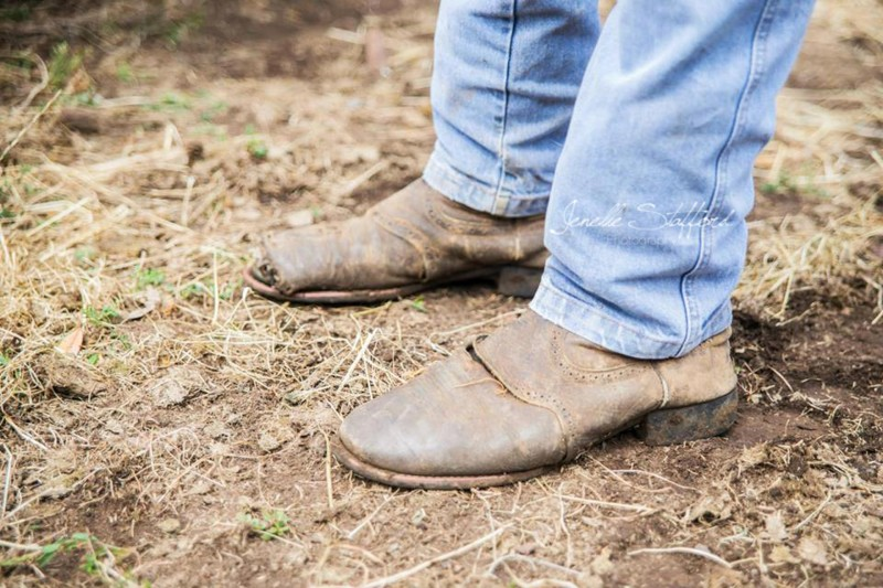 A pair of boots that have seen more hard work in cattle yards than many people will in their entire life.