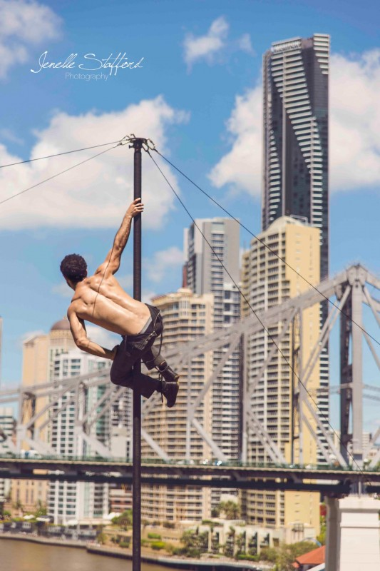 Internationally acclaimed circus artist, Felix Pouliot, on Chinese pole in Brisbane, Queensland.