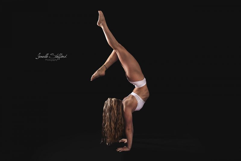Circus artist and gymnast, Rachael Armstrong, displaying her flexibility and handstand prowess during a studio photoshoot on the Gold Coast.